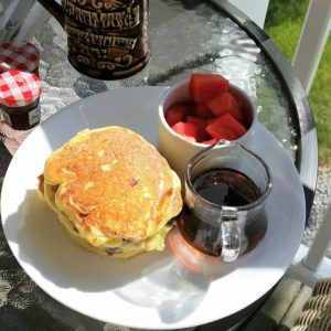 Pancakes, maple syrup and fruit salad