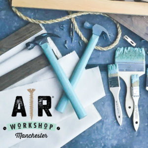 Blue Hammers and paint brushes with AR Workshop logo