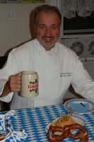 """Chef Rob """"Prosting"""" with beer and pretzel"""