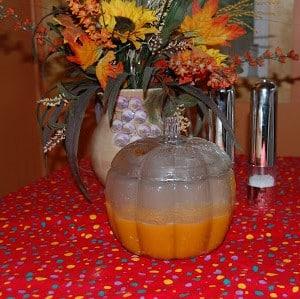Hot pumpkin Soup in a Pumpkin Bowl in fall setting